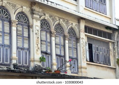 Vintage style windows of old town Chino-Portuguese buildings in Phuket, Thailand