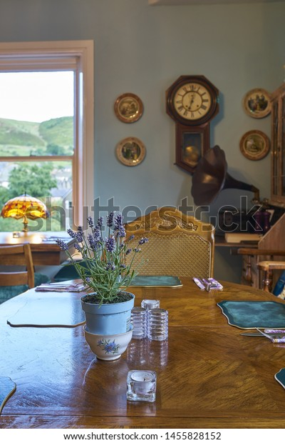 Vintage styled restaurant dining room with a rural village view though the window