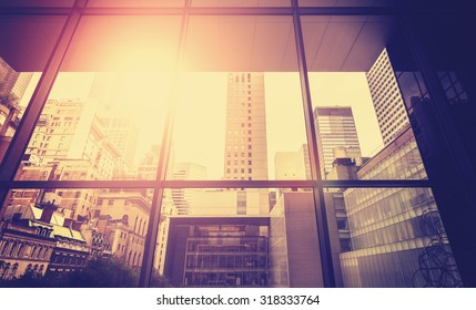 Vintage stylized picture of Manhattan with sun flare effect, New York City, USA.