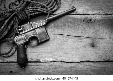 vintage submachine gun Mauser on old wooden background