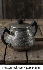 Vintage Sugar Bowl on rustic kitchen table. Old kitchen utensils, selective focus