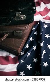 Vintage suit cases on US flag. Travel America concept