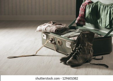 Vintage suitcase open on a wood floor, close up