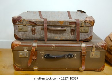 Vintage suitcases with leather straps