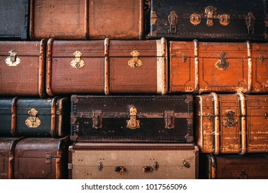 Vintage suitcases stacked in a heap. Traveling concept. Background