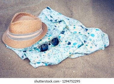 6167a0fc Vintage summer wicker straw beach hat, pareo and sunglasses on the seashore  of Catania,