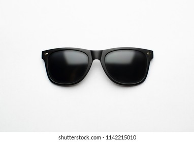 Vintage sunglasses with black plastic frame on white background