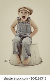 vintage surprise:  joyful little boy in overalls