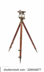 Vintage Surveyor's Level (Transit, Theodolite) with aged Brass Patina  on a Wooden Tripod,   focus stacked and isolated on white background.