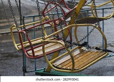 a vintage swing in the rain