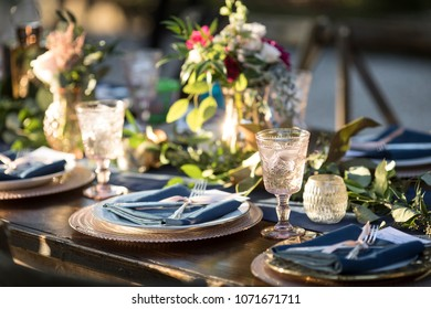 Vintage table setup for outdoor wedding reception.