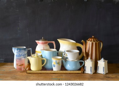 vintage tableware, coffee pots,mugs coffee filter on dark background, good copy space