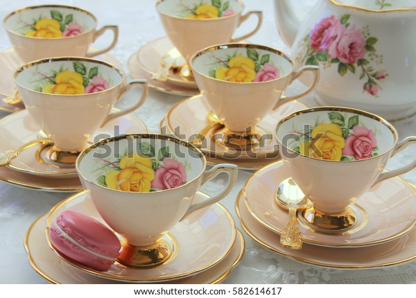 vintage tea cup set with macaroon and roses