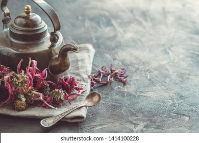 Vintage teapot of healthy echinacea tea and dry coneflower buds.