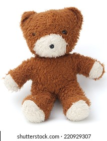 A vintage teddy bear photographed against a white background