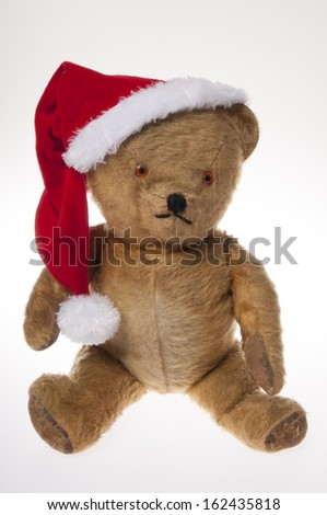 785a939ce09bf Vintage teddy bear wearing a santa hat isolated on white background