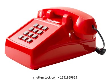 Vintage telecommunication technology and retro household items concept with a red push button telephone isolated on white background with a clip path cutout