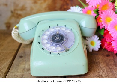 Vintage telephone and beautiful flower, Still life