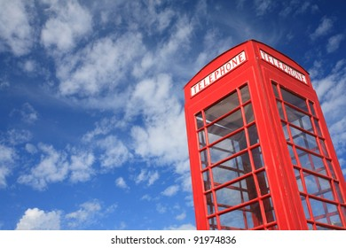 vintage Telephone box with blue sky.