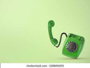 Vintage telephone on colored background