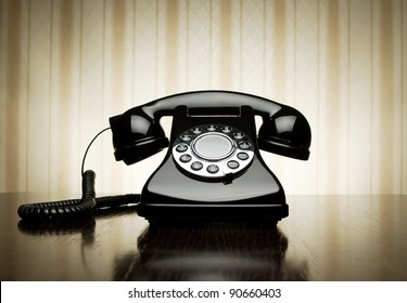 Vintage telephone over striped wallpaper