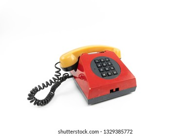 Vintage telephone. Red old phone isolated on white background.