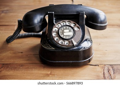 Vintage telephone in wooden background