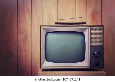 Vintage Television against a blank wall