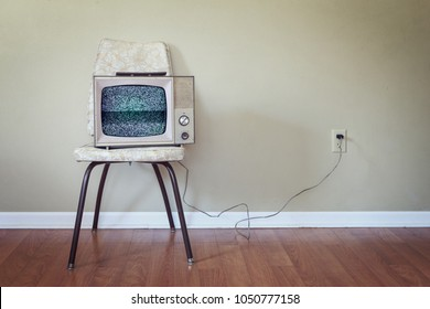 Vintage Television on an old chair with noise