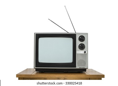 Vintage television on wood table isolated on white.