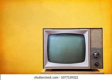 Vintage Television on a yellow background