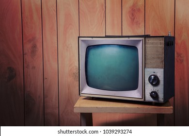 Vintage Television in a paneled room