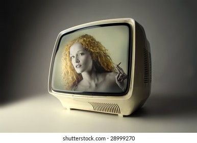 vintage television with woman smoking on the screen