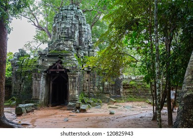 Vintage temple entrance and forest in Angkor Wat (Siem Reap, Cambodia).
