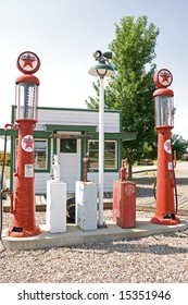 Vintage Texaco gas pumps in front of a filling station at a museum