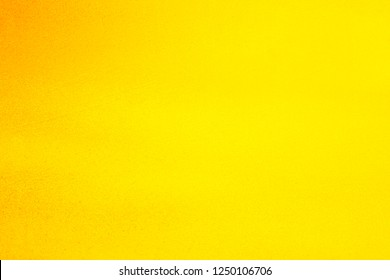 Vintage texture of yellow-orange wall for designer background. Concrete painted wall. Illuminated surface. Bright background. Raster image.