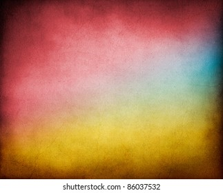 A vintage, textured paper background with multicolored gradients.  Image has a pleasing paper texture and grain at 100%.