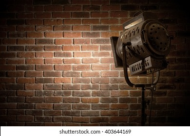 vintage theater / movie spot light focused on a brick wall background
