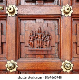 Vintage timber panel with Hindu carvings of Lord Murugan, Goddess Parvati and Lord Shiva.