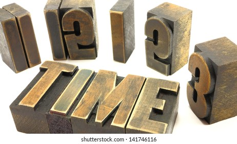 Vintage time concept using letter press letters aligned in the shape of a clock face with the word time