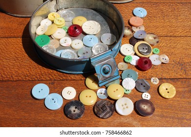 vintage tin of buttons