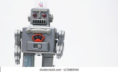 Vintage tin toy robot on the white background.