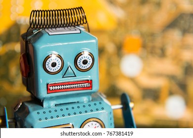 Vintage tin toy robot with orange computer circuit board background, artificial intelligence concept