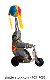 Vintage tin wind-up toy, elephant on tricycle with ball