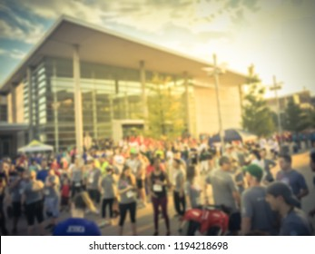Vintage tone abstract background employee in uniform attend 5K Corporate Challenge race in Richardson, Texas, USA. Blurred concept diverse multiethnic group of participant at urban sport event