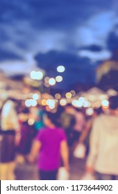 Vintage tone  abstract blur image of Food stall at Street night market in garden with bokeh for background usage .