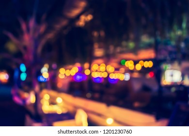Vintage tone abstract blur image of  restaurant or cafe on night time with bokeh for background usage.