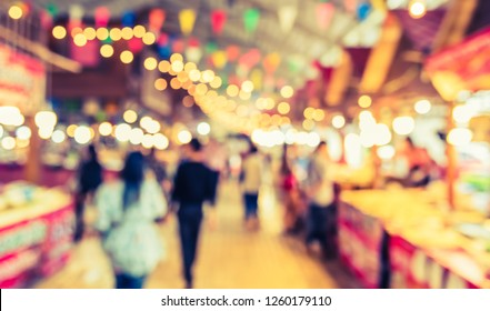 Vintage tone Abstract blur image of  Indoor Day Market with bokeh for background usage .