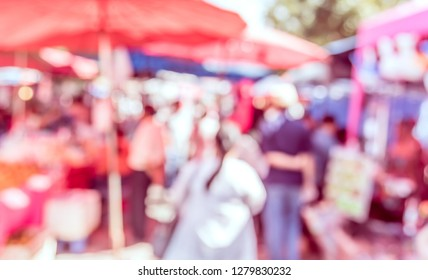 Vintage tone abstract blur image of Day market  on street with bokeh for background usage .