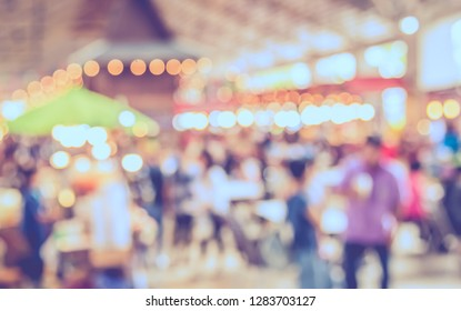 Vintage tone abstract blur image of  Indoor Day Market with bokeh for background usage.